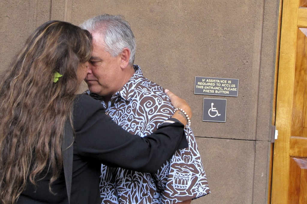 FILE - In this April 20, 2015, file photo Mike McCartney, center, Gov. David Ige's former chief of staff, greets Mauna Kea telescope opponent Kealoha ...