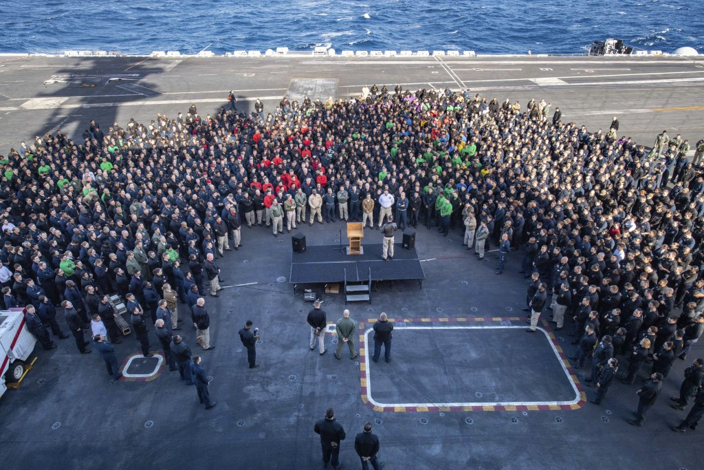 FILE - In this Dec. 15, 2019, file photo, U.S.Navy Capt. Brett Crozier, commanding officer of the aircraft carrier USS Theodore Roosevelt (CVN 71), ad...