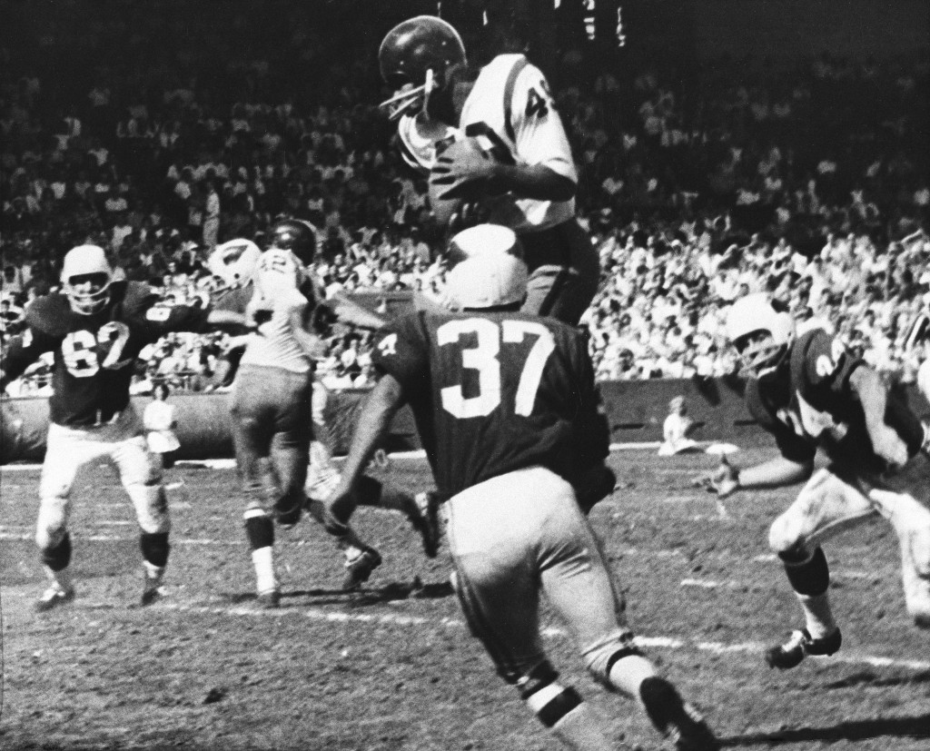 FILE - In this Oct. 15, 1962, file photo, Bobby Mitchell, of the Washington Redskins, jumps to haul in a pass from quarterback Norman Snead in the sec...