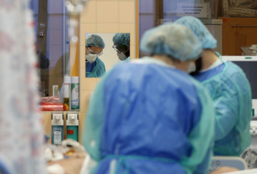Healthcare workers attend to a COVID-19 patient in an intensive care unit (ICU) at the General University Hospital in Prague, Czech Republic, Tuesday,...
