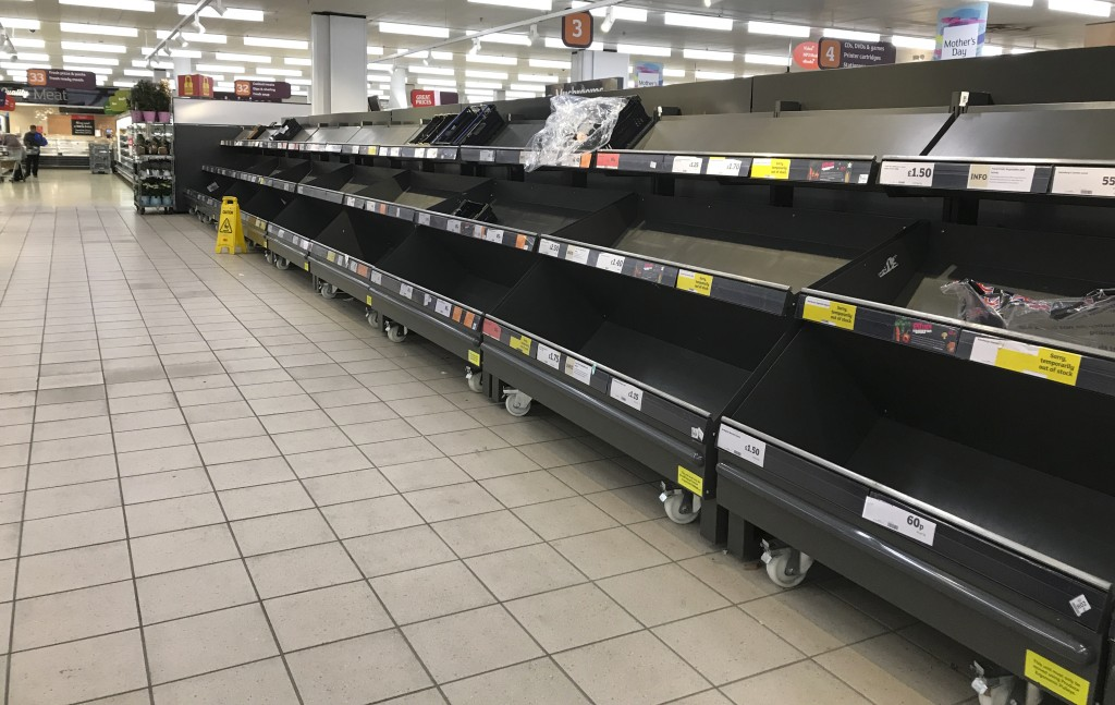 FILE - This Thursday, March 19, 2020 file photo shows empty shelves in a supermarket in London, amid panic-buying due to the coronavirus outbreak. A p...