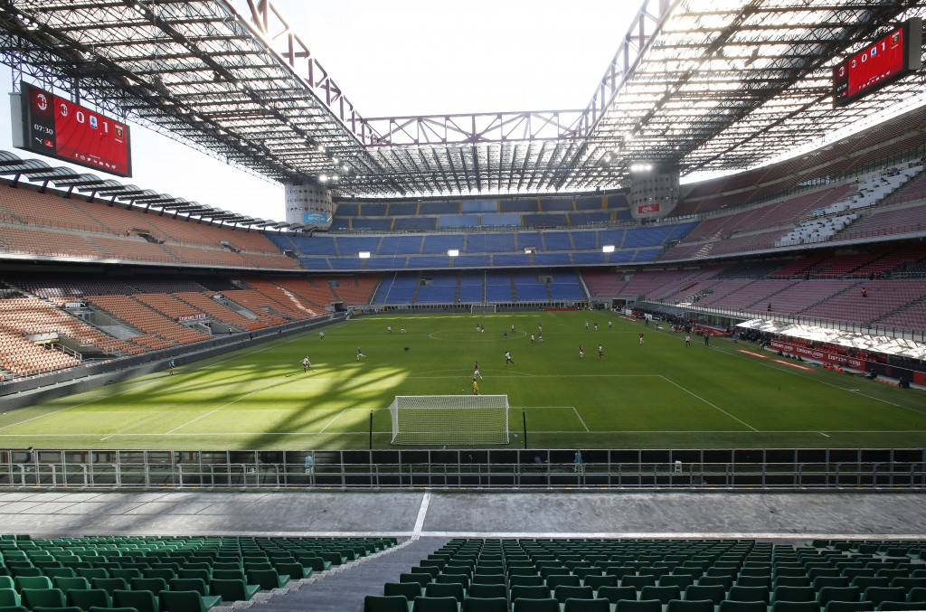 FILE - In this Sunday, March 8, 2020 file photo, a view of the empty San Siro stadium during the Serie A soccer match between AC Milan and Genoa, in M...