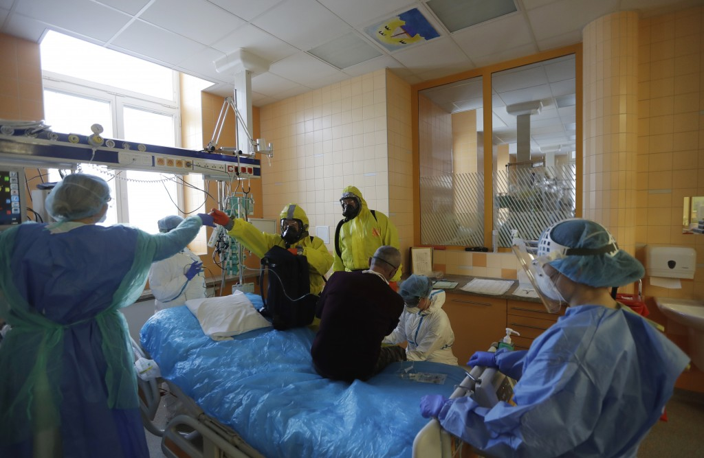 Healthcare workers admit a new COVID-19 patient into an intensive care unit (ICU) at the General University Hospital in Prague, Czech Republic, Tuesda...