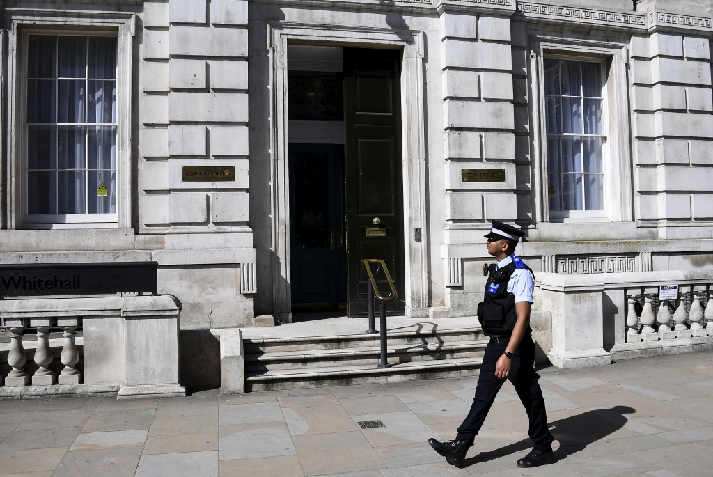 A police officer patrols in front of the cabinet office as British Prime Minister Boris Johnson is in intensive care fighting the coronavirus in Londo...