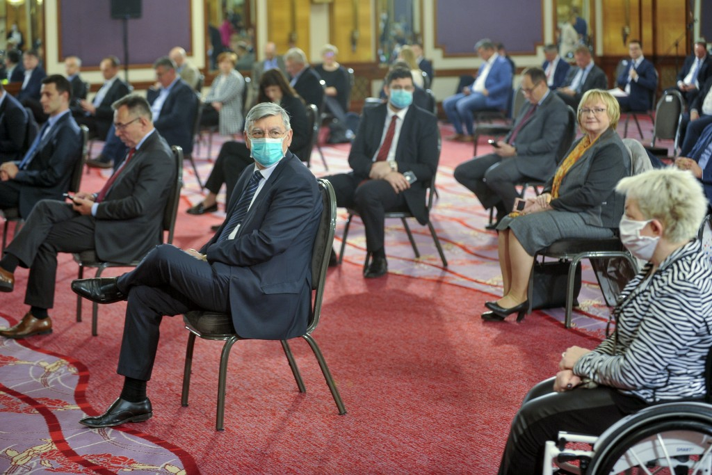 Croatian parliament members attend a session at a hotel in Zagreb, Tuesday, April 7, 2020. Croatian lawmakers have met at a conference hall in a Zagre...