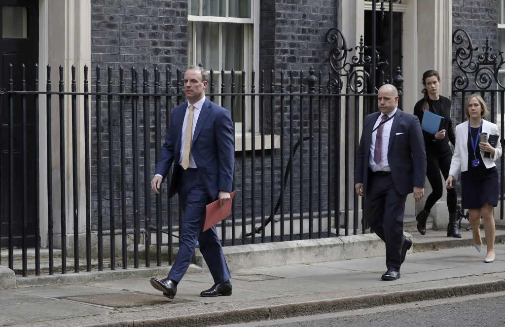 Britain's Secretary of State for Foreign Affairs, Dominic Raab, left, leads cabinet members as they leave 10 Downing Street after a meeting as British...