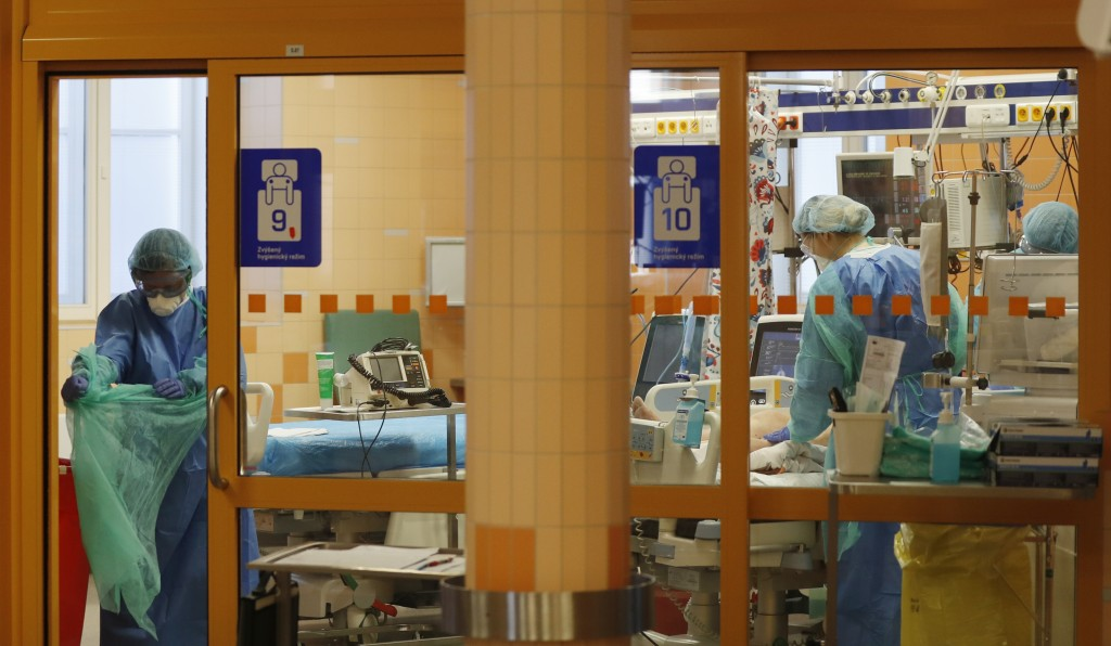 Healthcare workers attend to a COVID-19 patient at an intensive care unit (ICU) at the General University Hospital in Prague, Czech Republic, Tuesday,...