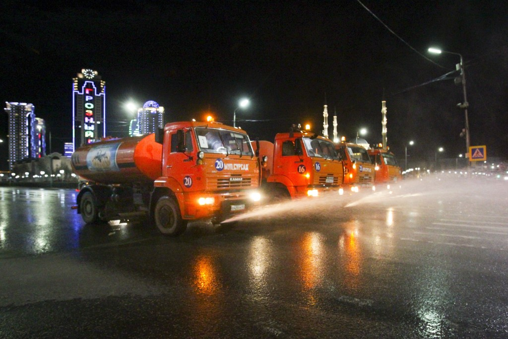 Municipal tankers spray disinfectant as a precaution against the coronavirus, on a street in the center of Grozny, Russia, Monday, April 6, 2020. Ramz...