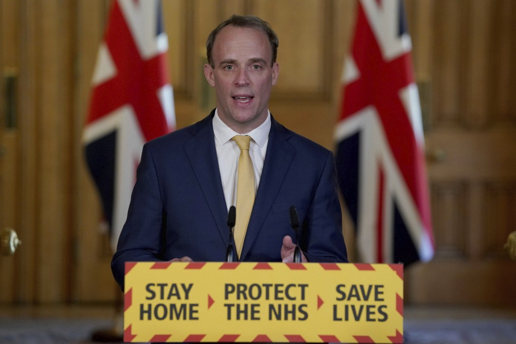 In this handout photo provided by 10 Downing Street, Britain's Foreign Secretary Dominic Raab speaks during a media briefing on coronavirus in Downing...