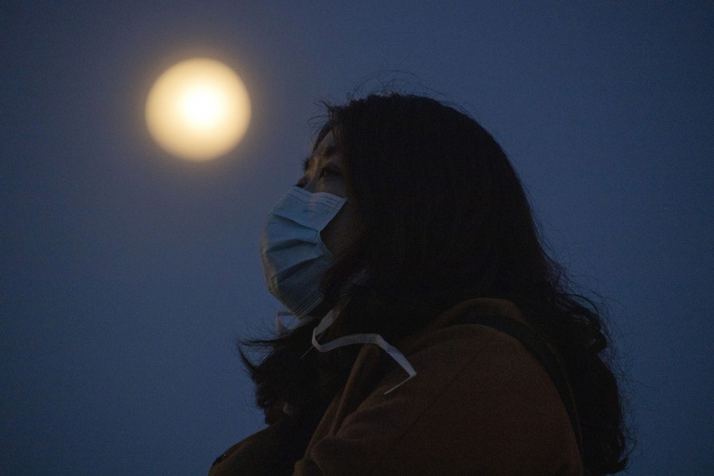 China sees slight rise in new coronavirus infections as imported cases jump