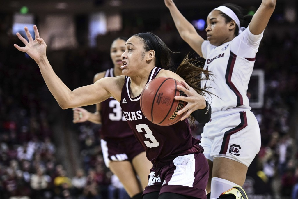FILE - In this Sunday, March 1, 2020, file photo, Texas A&M guard Chennedy Carter (3) drives against South Carolina guard Zia Cooke (1) during the sec...