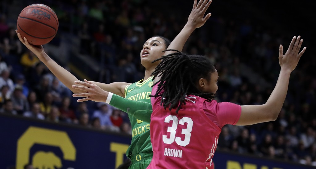 FILE - In this Friday, Feb. 21, 2020, file photo, Oregon's Satou Sabally, left, shoots past California's Jaelyn Brown (33) in the first half of an NCA...