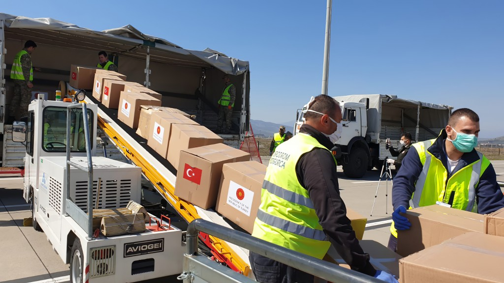 In this handout photo provided by the Turkish Defense Ministry, Serbian officials unload Personal Protection Equipment donated by Turkey to help the c...