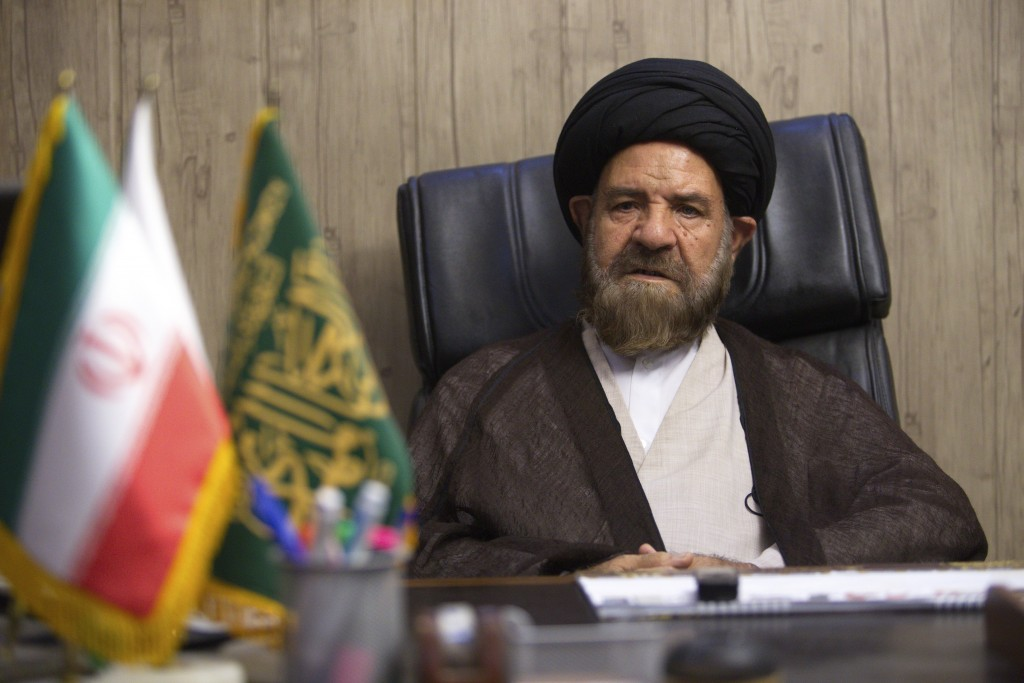 In this Aug. 3, 2016 photo, Ayatollah Hashem Bathaei Golpayegani, a member of Iran's Assembly of Experts, speaks in his office, in Tehran, Iran. On Ma...