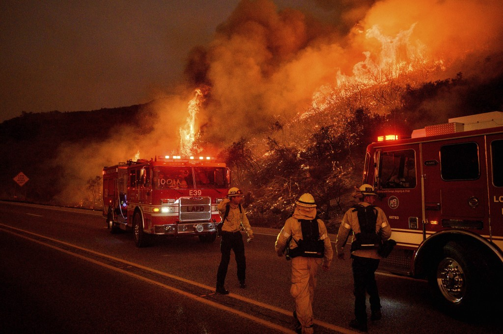 FILE - In this Nov. 26, 2019, file photo, firefighters battle the Cave Fire as it flares up along Highway 154 in the Los Padres National Forest above ...