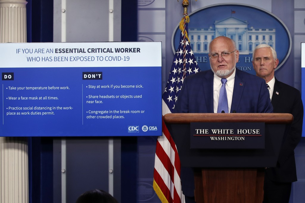 Dr. Robert Redfield, director of the Centers for Disease Control and Prevention, speaks as charts are displayed during a briefing about the coronaviru...