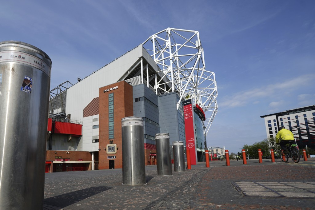 Bollards stand raised outside the closed Manchester United stadium, Old Trafford, in Manchester, northern England, as the English Premier League socce...