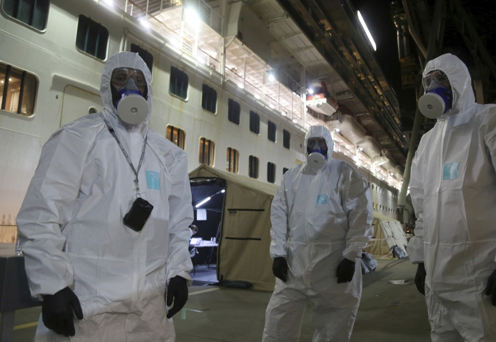 In this Wednesday, April 8, 2020, photo provided by the New South Wales Police, investigators in protective gear prepare to board the Ruby Princess cr...