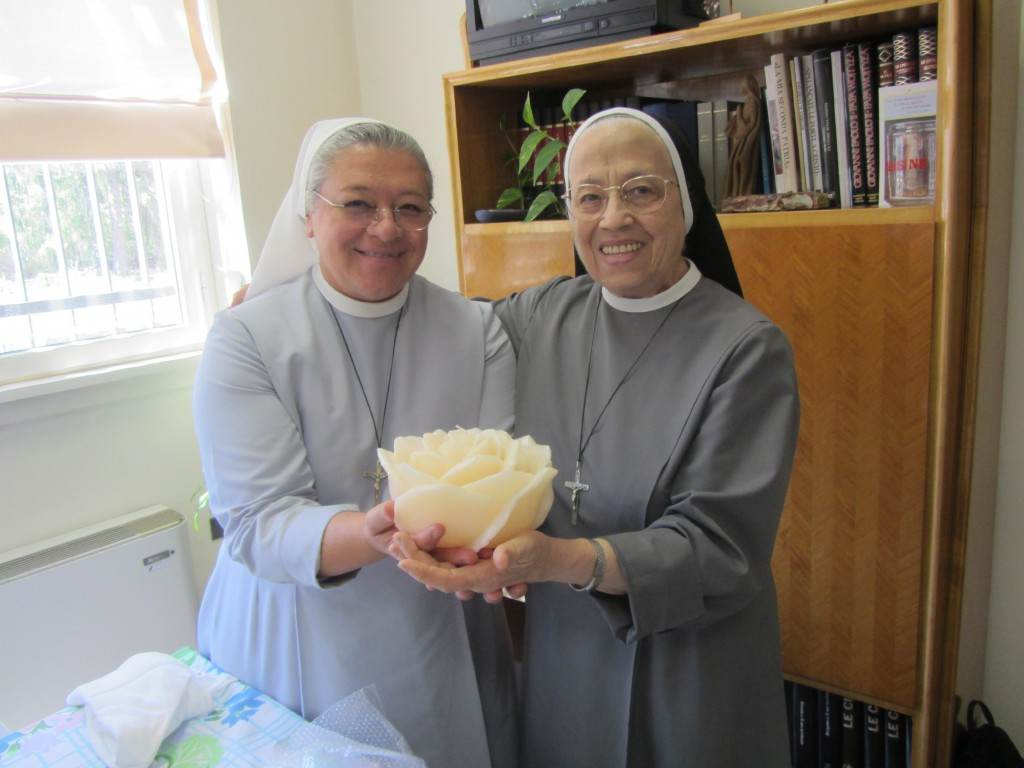 This undated photo provided by Sister Maria Mabel Spagnuolo shows her, left, with Sister Maria Ortensia Turati. On March 16, 2020, Turati, who was the...