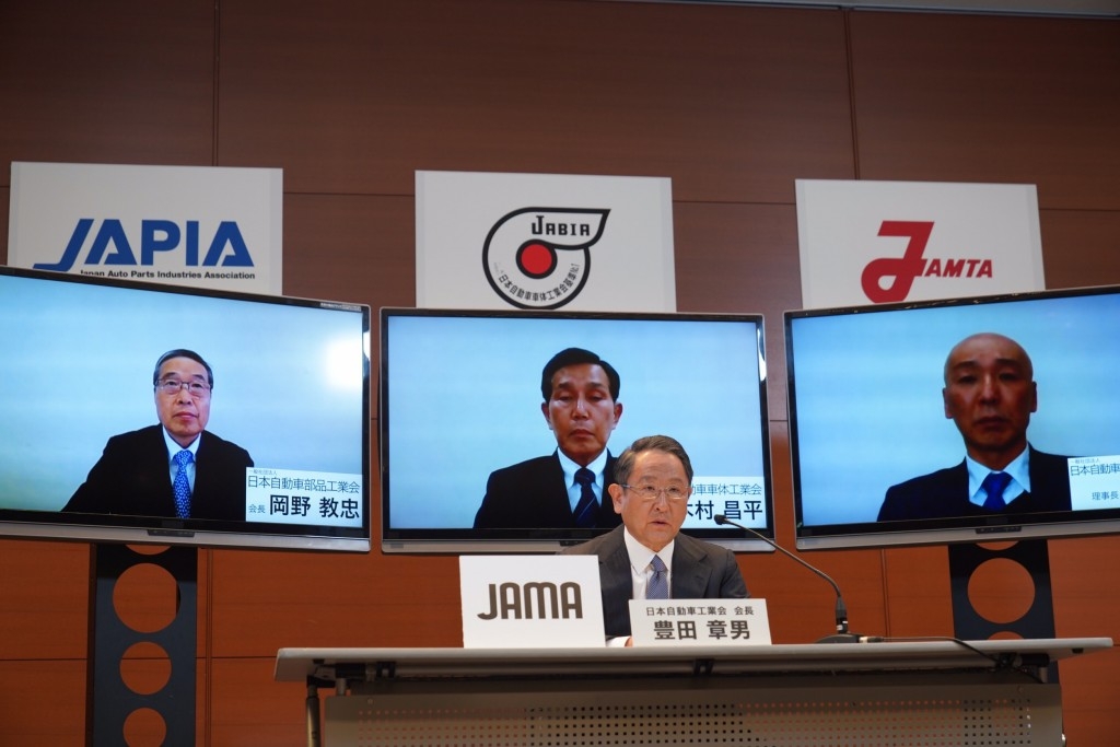In this photo provided by Toyota Motor Corp., Toyota Chief Executive Akio Toyoda speaks during a video meeting at his office in Nagoya, central Japan,...