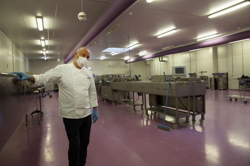One of Belgium's top chocolate producers Dominique Persoone stands in one of his production rooms with no workers, at his Chocolate Line warehouse in ...
