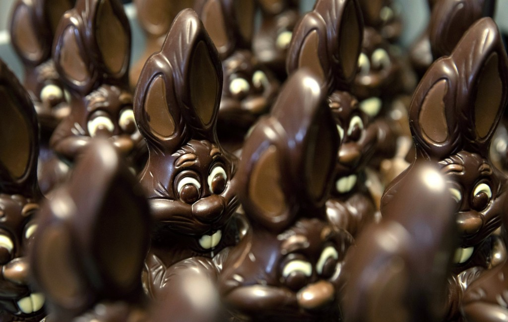 In this photo taken on Wednesday, April 8, 2020, chocolate rabbits wait to be decorated at the Cocoatree chocolate shop in Lonzee, Belgium. As all non...