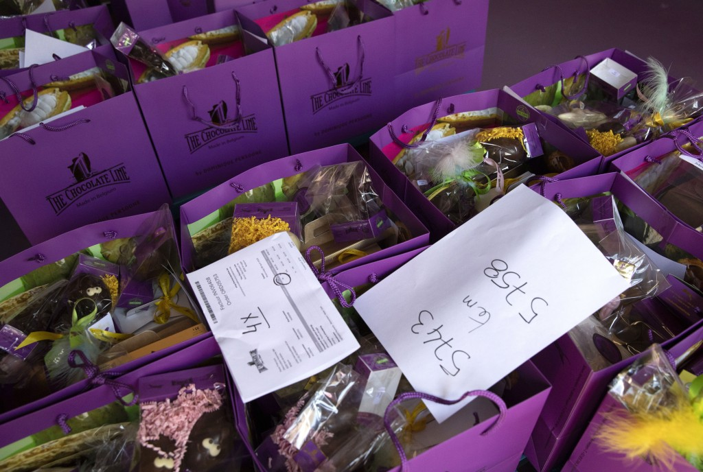Order slips are placed on top of bags of chocolate waiting to be picked up at the Chocolate Line production warehouse in Bruges, Belgium, Friday, Apri...