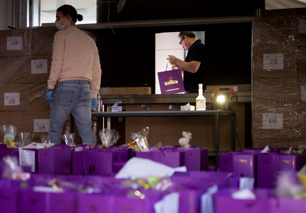 A client walks away with an order of chocolate picked up from a makeshift window at the Chocolate Line warehouse of Dominique Persoone in Bruges, Belg...