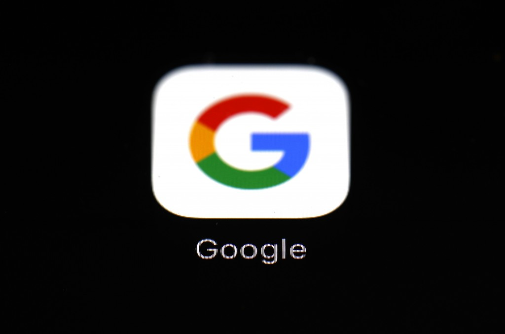 FILE - This March 19, 2018 file photo shows a Google app in Baltimore.   Apple and Google launched a major joint effort, Friday, April 10, 2020,  to l...