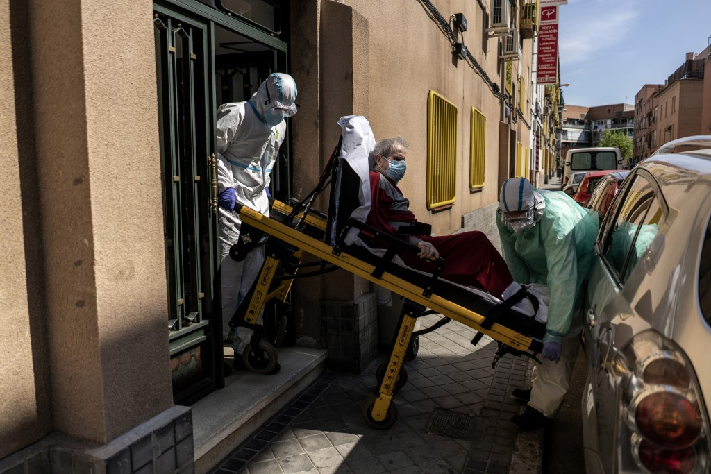 Enrique, a 92 year old man is taken out of his home by medics to a waiting ambulance after he showed signs of possible coronavirus symptoms with serio...