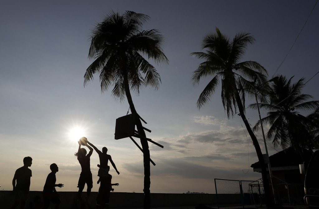 Filipino men play basketball amid an enhanced community quarantine to prevent the spread of the new coronavirus in Manila, Philippines on Monday April...