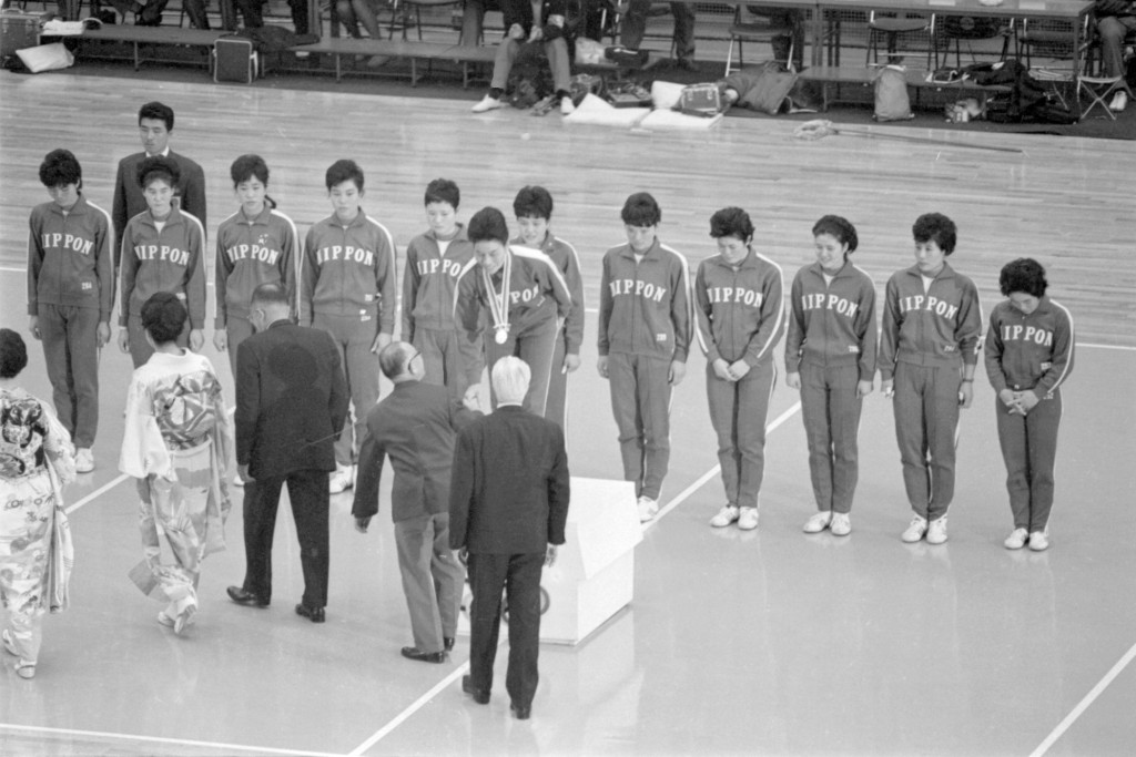 FILE - In this Oct. 23, 1964, file photo, Japan's players celebrate with their gold medals following an award ceremony after defeating the Soviet Unio...