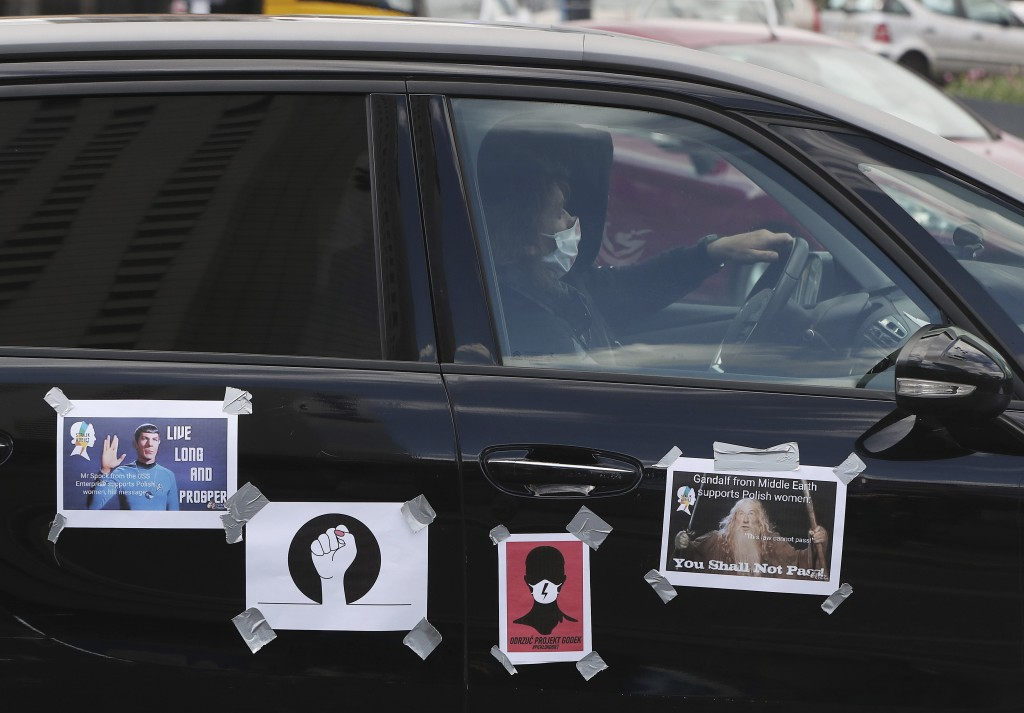 Women, self isolated in their cars to protect against coronavirus, take part in a protest against plans for the parliament to debate a draft law tight...