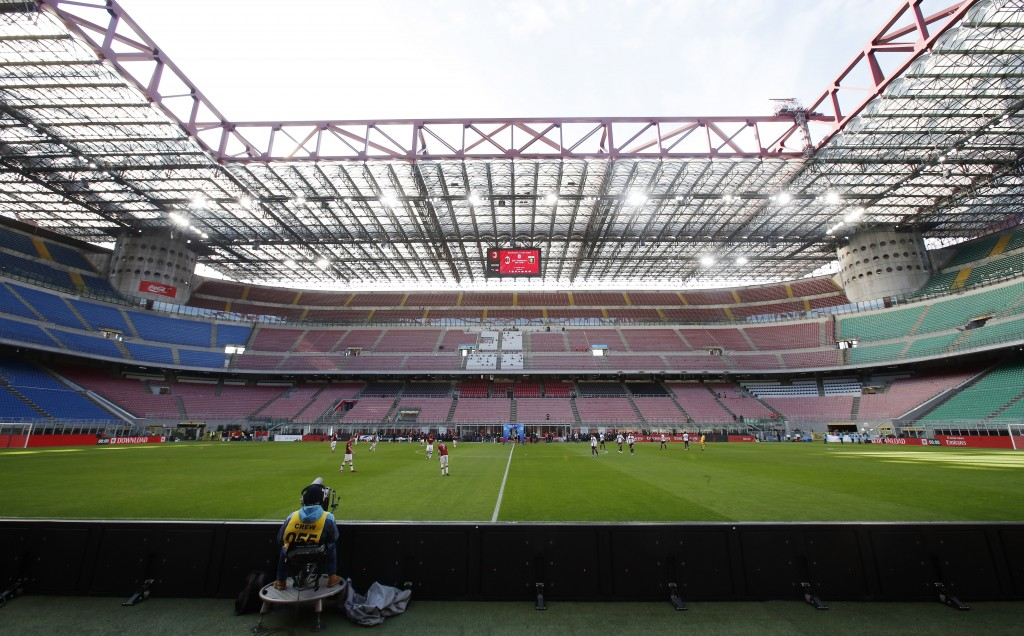 FILE - In this Sunday, March 8, 2020 filer, a view of the empty stadium during the Serie A soccer match between AC Milan and Genoa at the San Siro sta...
