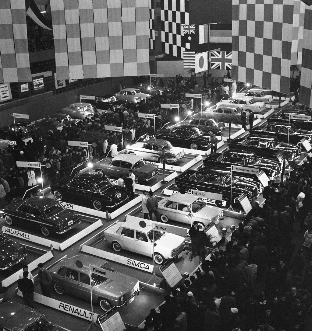 FILE - In this Jan. 13, 1963, file photo, a crowd of people pack Tokyo Metropolitan Gymnasium at the opening of the 1963 International Automobile Show...
