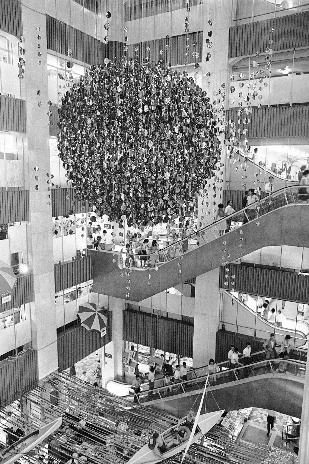 FILE - In this July 28, 1964, file photo, the vast stairwell provides room for dramatic special displays in the Matsuya Department Store in Tokyo's Gi...