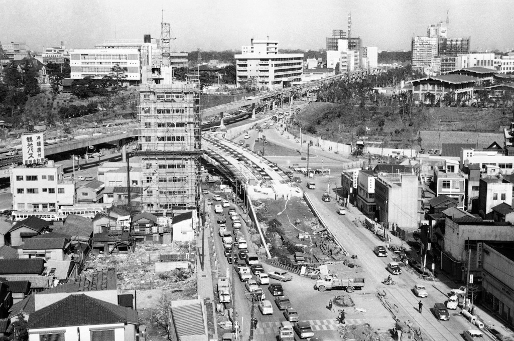 FILE - In this April 13, 1964, file photo, the changing face of Tokyo shows itself in this view which includes the gigantic Miyake-Zaka underground hi...