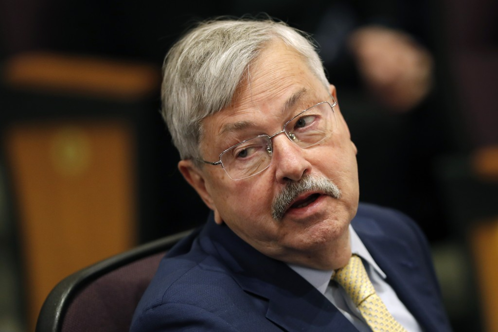 FILE - In this March 4, 2019 file photo, U.S. Ambassador to China Terry Branstad listens to Secretary of State Mike Pompeo speak at an event in Johnst...