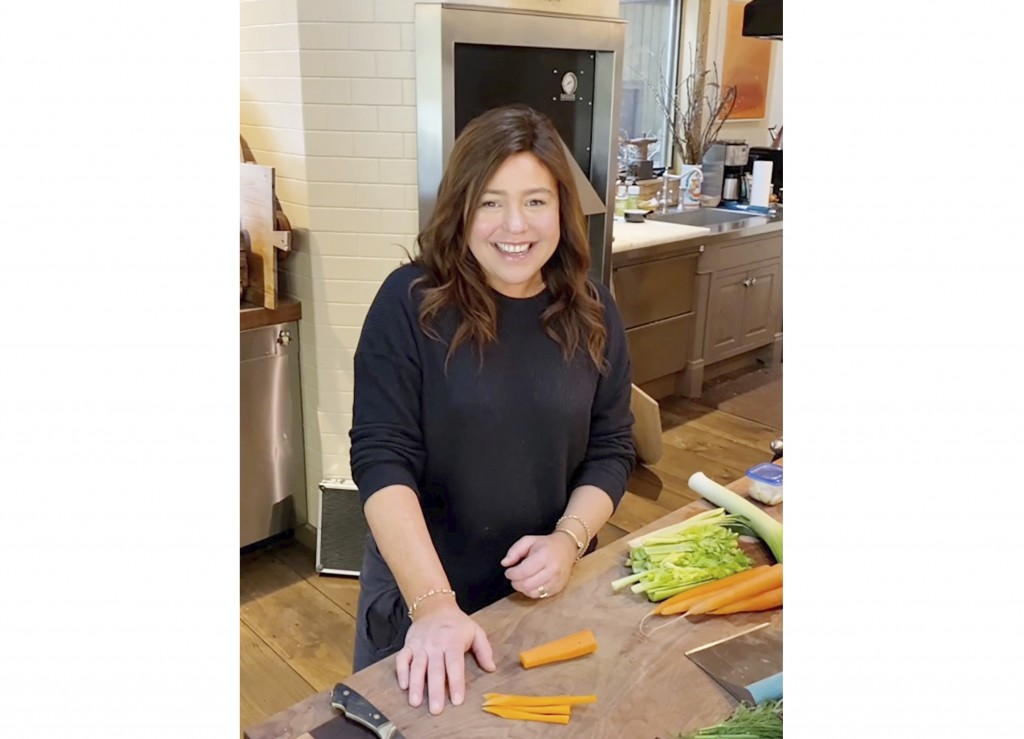 """In this undated photo made available by the Rachael Ray Show, Rachael Ray cooks in her home kitchen in upstate New York. Ray is taping """"#STAYHOME With..."""