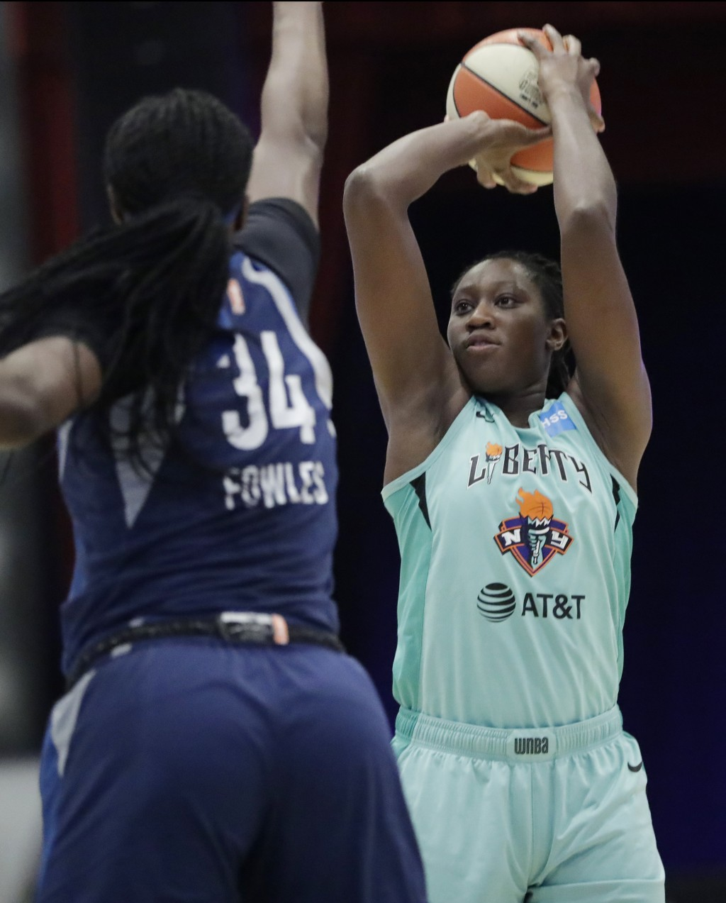 FILE - In this Aug. 13, 2019, file photo, New York Liberty center Tina Charles shoots as Minnesota Lynx center Sylvia Fowles (34) defends during the f...