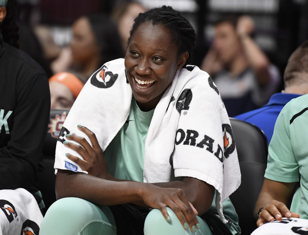 FILE  - In this May 14, 2019, file photo, New York Liberty's Tina Charles smiles on the bench during the second half of a preseason WNBA basketball ga...