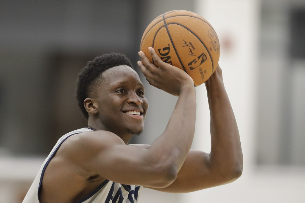 FILE - In this Jan. 28, 2020, file photo, Indiana Pacers' Victor Oladipo shoots during practice at the team's NBA basketball training facility in Indi...