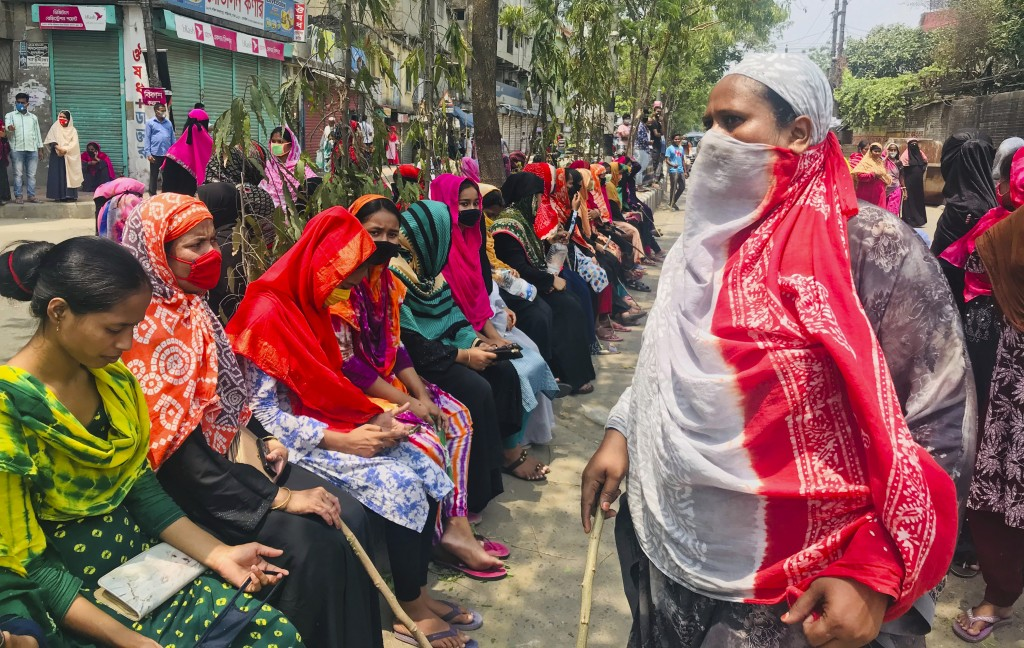 Bangladeshi garment workers block a road demanding their unpaid wages during a protest in Dhaka, Bangladesh, Thursday, April 16, 2020. Hundreds of Ban...