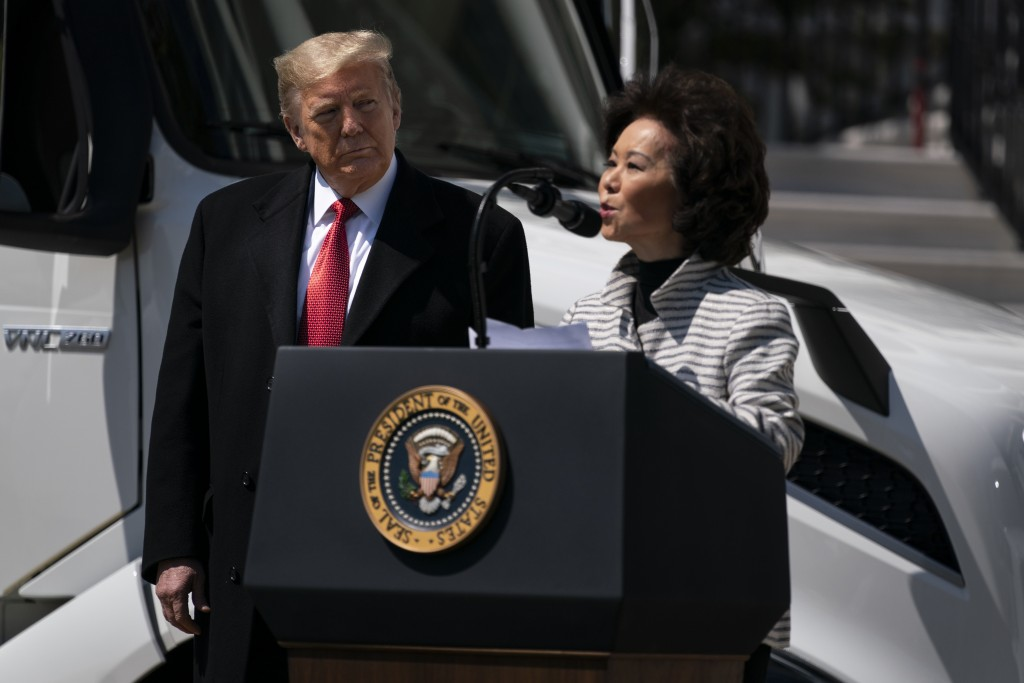 President Donald Trump listens as Secretary of Transportation Elaine Chao speaks during an event celebrating American truckers, at the White House, Th...