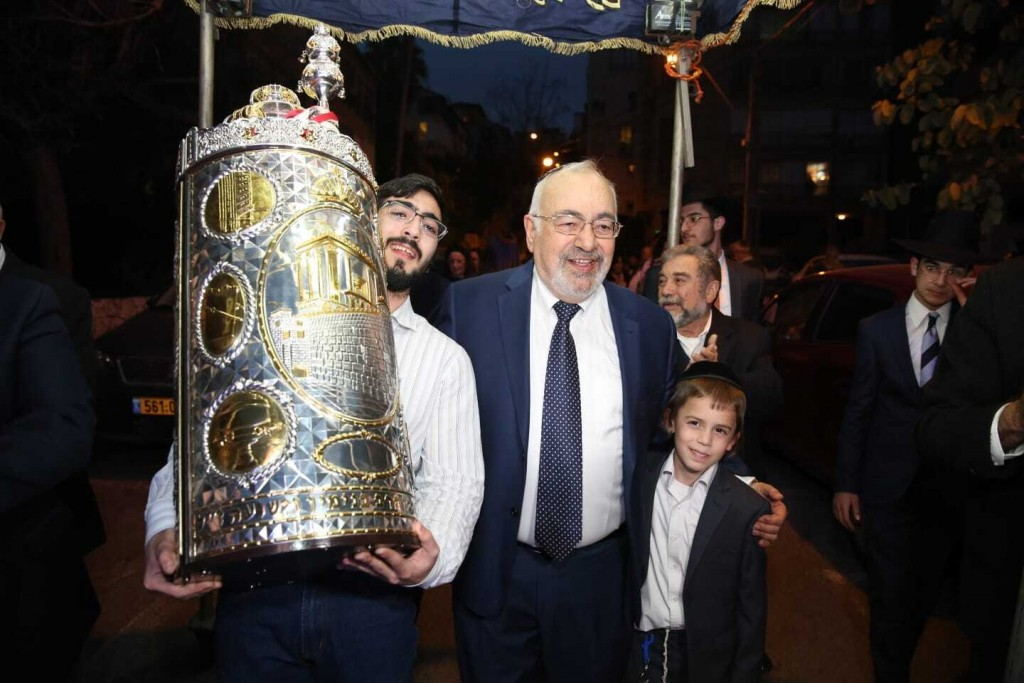 This undated photo shows Simha Benshai, center, at synagogue celebration with relatives in Tel Aviv, Israel. Benshai, 75, died from coronavirus at a T...