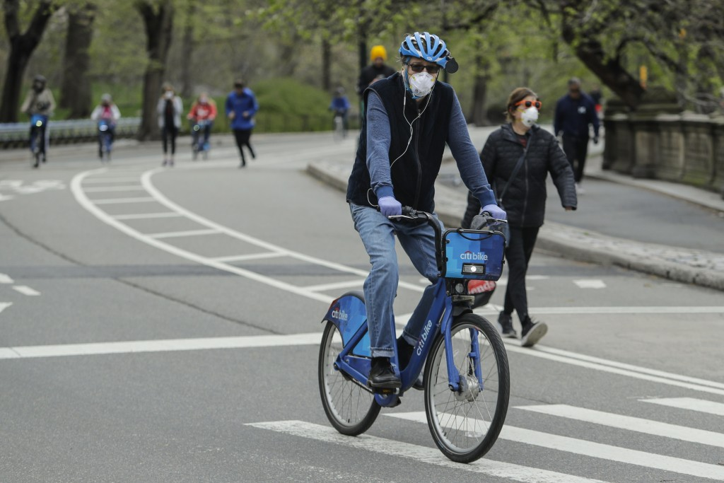 Cyclists and pedestrians make their way through Central Park during the coronavirus pandemic Saturday