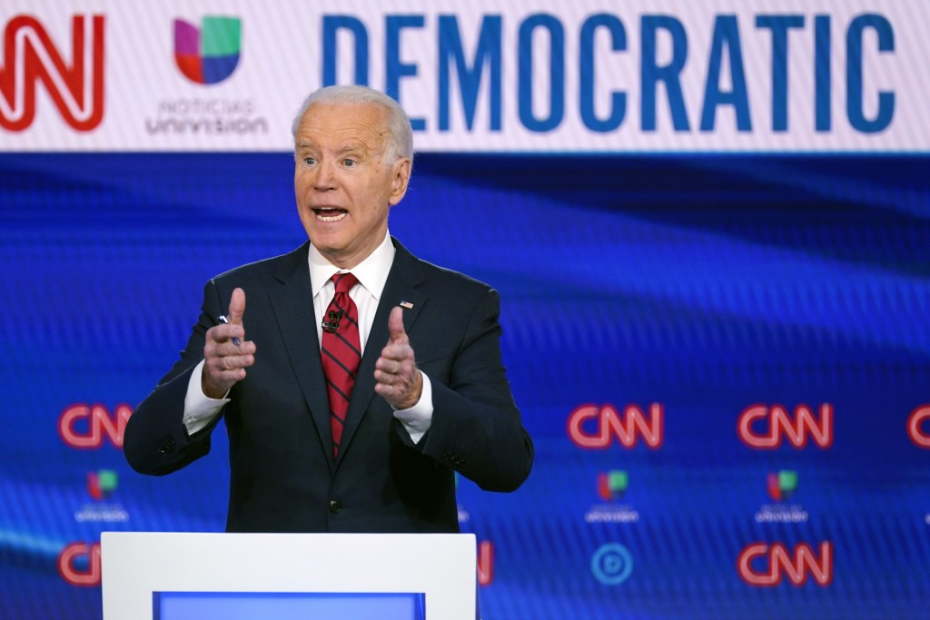 FILE - In this March 15, 2020, file photo, former Vice President Joe Biden, participates in a Democratic presidential primary debate with Sen. Bernie ...