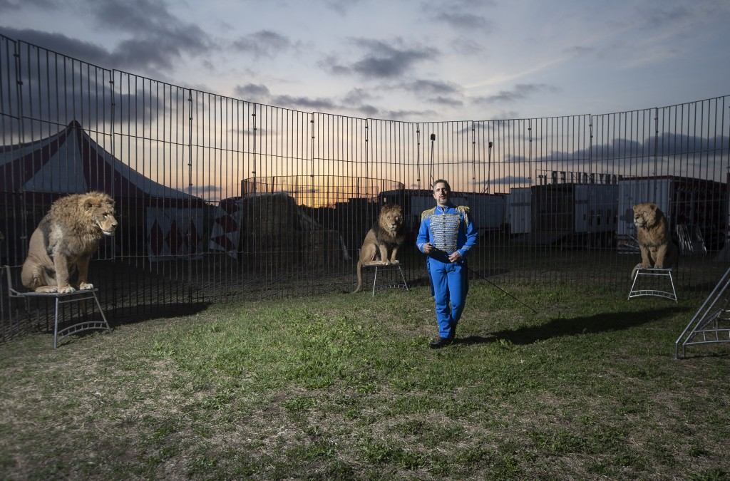 """Rony Vassallo poses for a portrait with his lions at the Rony Roller circus, parked on the outskirts of Rome, Saturday, April 18, 2020. """"It is strange..."""