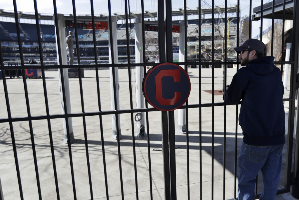FILE - In this March 26, 2020, file photo, Jason Hackedorn looks into Progressive Field, home of the Cleveland Indians baseball team, in Cleveland. Wi...