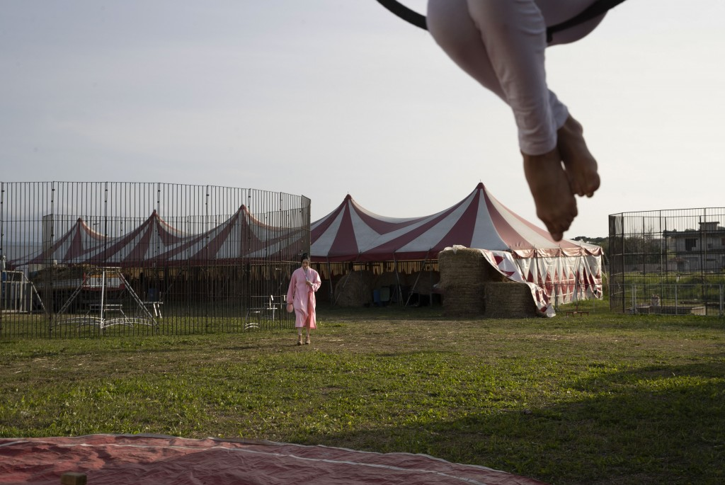 Otilia Maria Martinez Dos Santos, an artist of Portuguese origins, walks in the Rony Roller circus parked on the outskirts of Rome, Saturday, April 18...